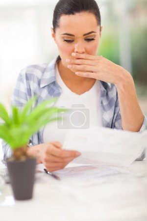 Photo for Young woman got shocked when receive her monthly bank statement - Royalty Free Image