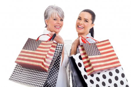 middle aged woman with her daughter shopping