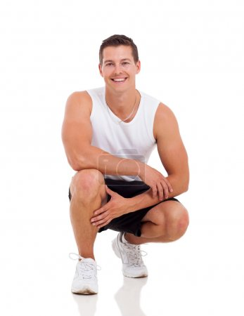 Photo for Sportive young man posing isolated on white - Royalty Free Image