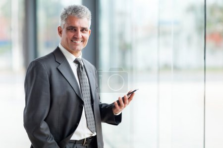 Senior business executive using tablet pc