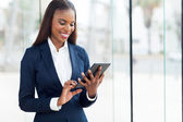 african businesswoman using tablet computer