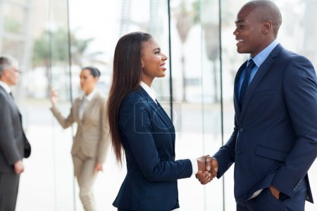 African business people handshaking