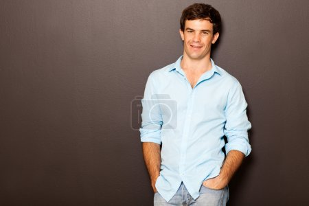 man posing with hands in pockets