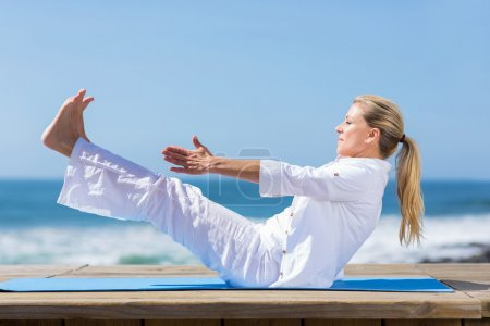 Healthy mid age woman yoga exercise
