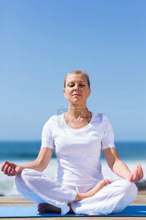 mid age woman meditating