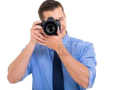 Foto de Foto de macho fotógrafo tomando sobre fondo blanco - Imagen libre de derechos