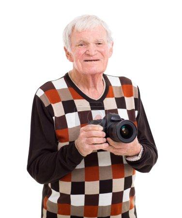 happy senior man holding a camera