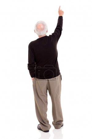 rear view of old man pointing at copy space