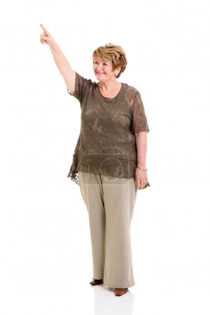senior woman pointing up