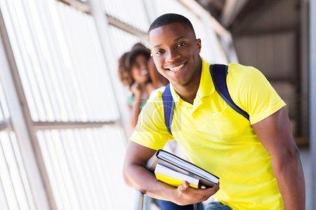 Foto de Alegre guapo afro americana estudiante libros - Imagen libre de derechos
