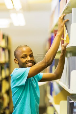 Student looking for books in library
