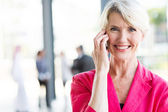 Mature businesswoman talking on cell phone