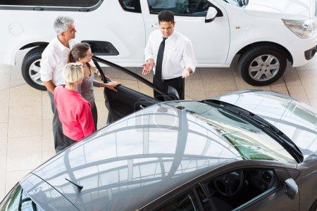 Car salesman showing vehicle