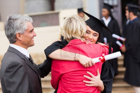 Photo for Happy female graduate embracing her mother after graduation - Royalty Free Image