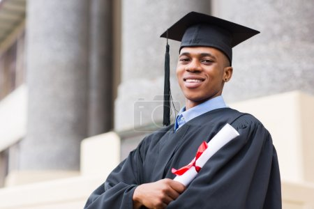 African graduate standing outside college