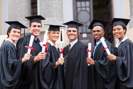 Photo for Group of young college graduates and professor at graduation - Royalty Free Image