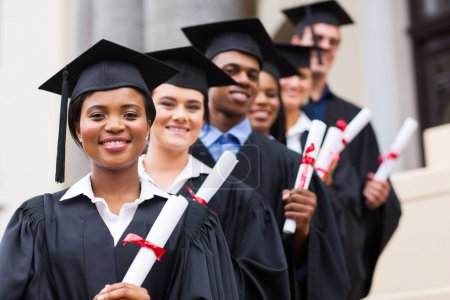 Smiling university graduates at graduation