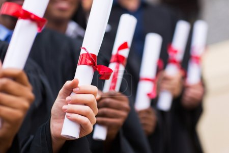 Graduates holding diploma