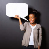 african american woman holding  speech bubble