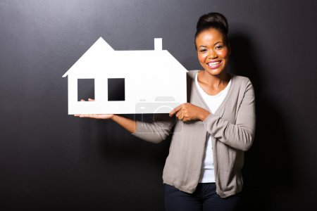 african american woman showing house symbol