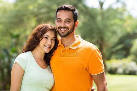 Photo for Portrait of beautiful young indian couple outdoors - Royalty Free Image