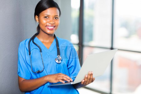 african healthcare worker using laptop