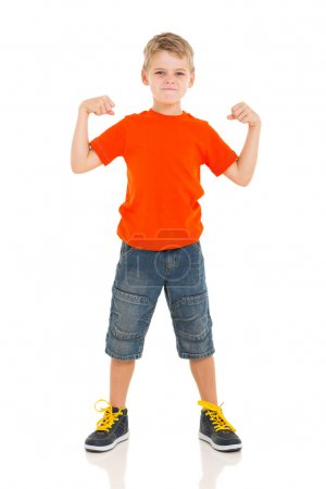 young boy with fists clenched