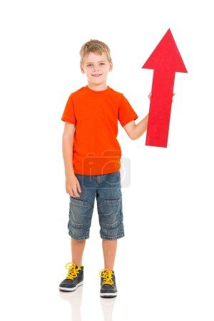 cute kid holding red arrow