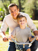 Father and son riding bicycle