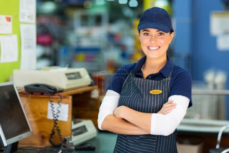 Cashier with arms folded