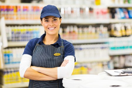 Photo for Portrait of pretty female supermarket worker with crossed arms - Royalty Free Image