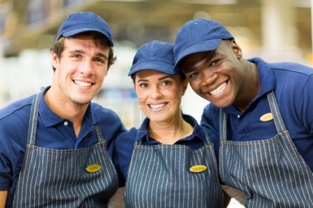Photo for Group of happy hardware shop workers embracing - Royalty Free Image