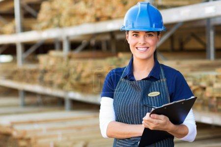 Worker holding clipboard