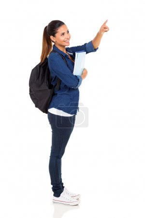 Photo for Female university student pointing at empty copy space - Royalty Free Image