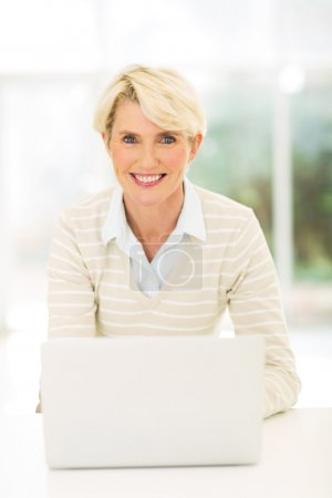 Middle aged woman with laptop