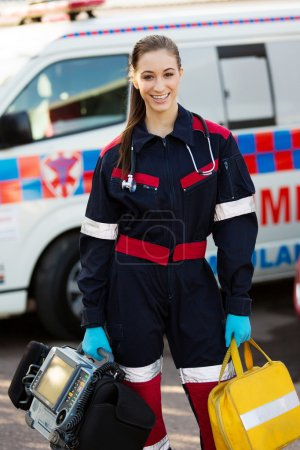 Female paramedic holding portrable devices