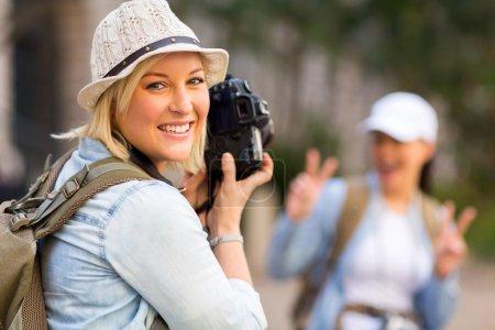 Tourist taking photo of friend