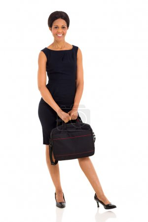Photo for Portrait of middle aged afro american businesswoman holding briefcase - Royalty Free Image