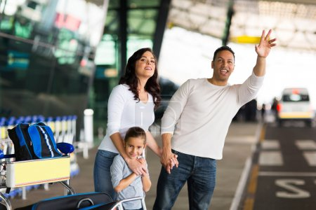 Man and  family hailing taxi