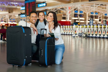 Family with luggage bags