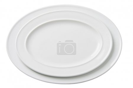 Two empty white oval plate isolated on white backg...
