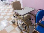 Empty wheelchair in a hospital