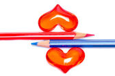 Red and blue pencils with romantic hearts