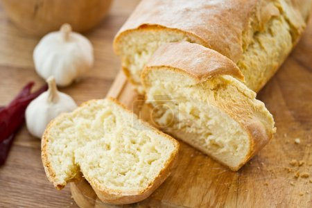 Photo for Slices of homemade bread on a wooden board - Royalty Free Image
