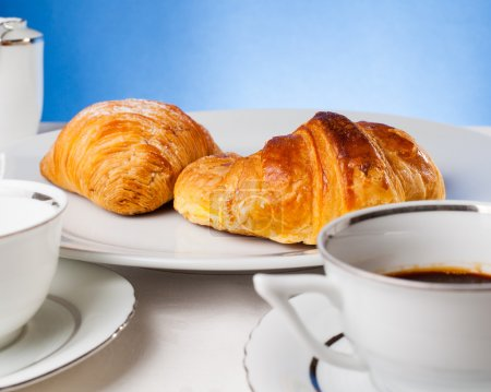 Coffee serrved with croissant and sfogliatella(typical Napoli sw