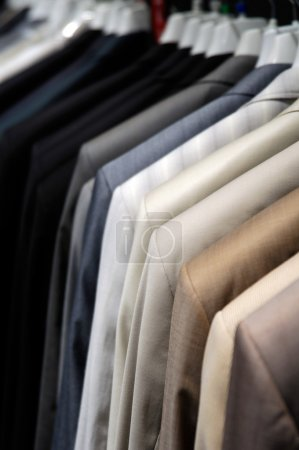 Photo for Suits on the hangers close-up - Royalty Free Image