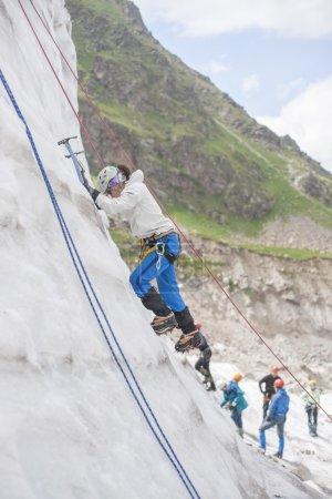 Girl climb up on the ice