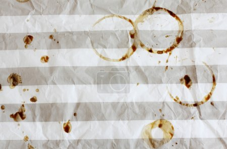 coffee cup stains in rumpled striped paper in cafe