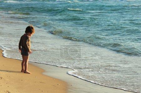 Little kid on the beach