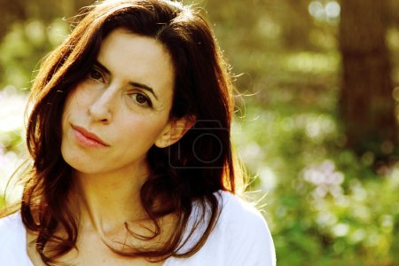 Portrait of beautiful 35 years old woman in summer forest